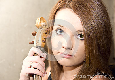 Beautiful young woman with violins