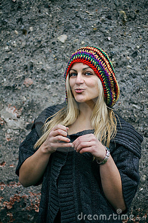 Beautiful young woman wearing rastafarian hat