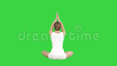 beautiful young woman wearing sportswear practicing yoga