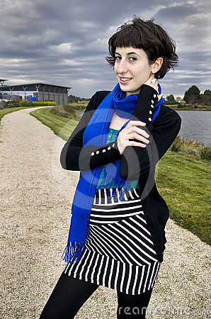 Beautiful young woman wearing striped skirt