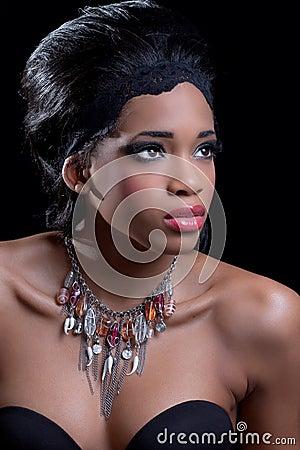Beautiful young woman wearing stylish necklace