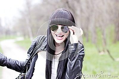 Beautiful young woman wearing sunglasses