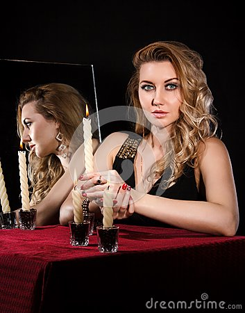 Free Beautiful Young Woman With Candles Near The Mirror Stock Photos - 53578543