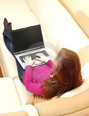 Beautiful young woman working on a laptop