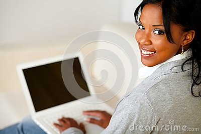Beautiful young woman working on laptop