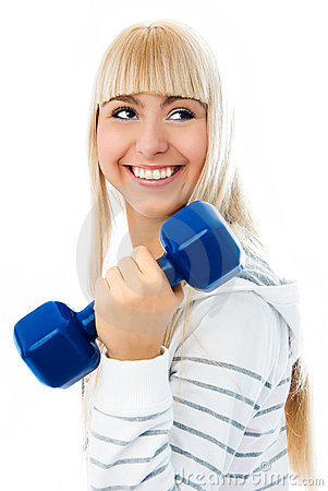 Beautiful young woman works out with dumbbells