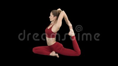 beautiful young womandoing yoga or pilates exercise one