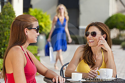 Beautiful Young Women Drinking Coffee At Cafe
