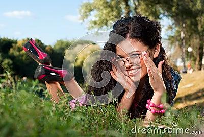 Beautiful young women lie on a grass