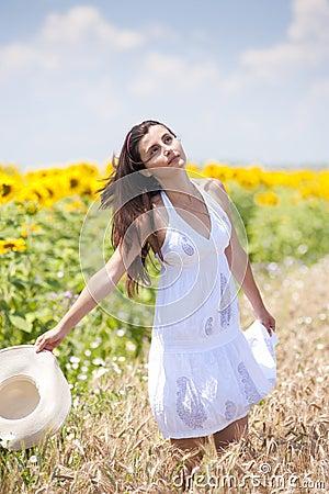 Beautifull girl playing in cropland