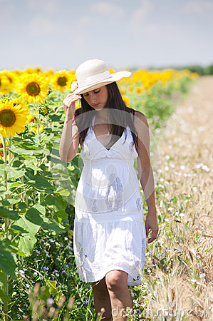 Beautifull girl walking in a cropland