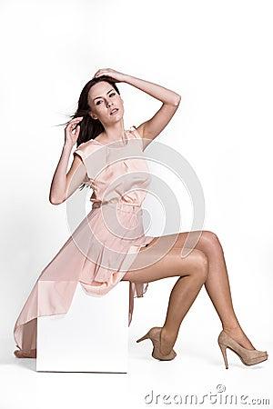 Beautifull woman in beige dress