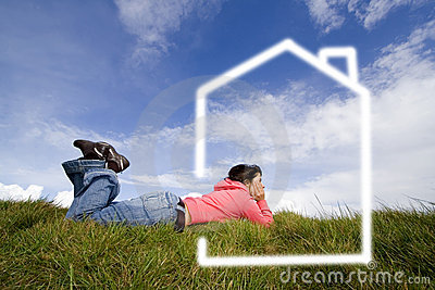 Beautifull woman in grass dreaming with new house