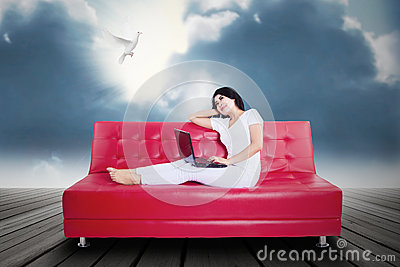 Beautifull woman using laptop on couch