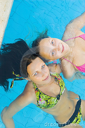Beautiul girls in a pool