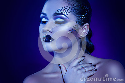 Beauty adult girl in cold tones with elegance make up