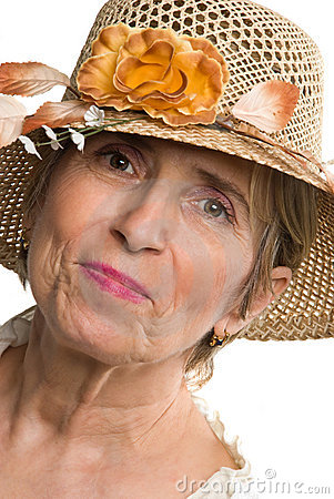 Beauty aged senior woman with summer hat