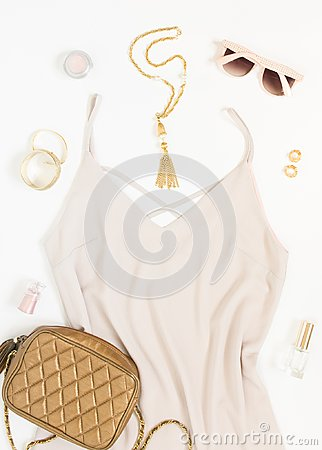 Free Beauty Blog Concept. Woman Outfit. Pink Dress, Pink Sunglasses, Gold Crossbody Bag, Bracelets, Necklace, Earrings And Cosmetics On Royalty Free Stock Photo - 102536855