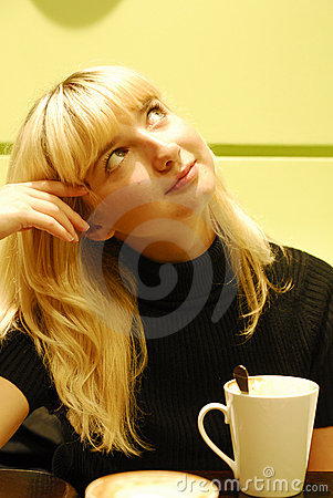 Beauty blond girl drinking coffee