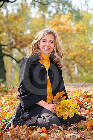 Beauty blond in park in autumn