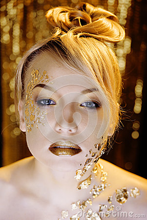 Beauty blond woman with gold creative make up