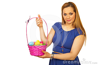 Beauty blond woman showing Easter basket