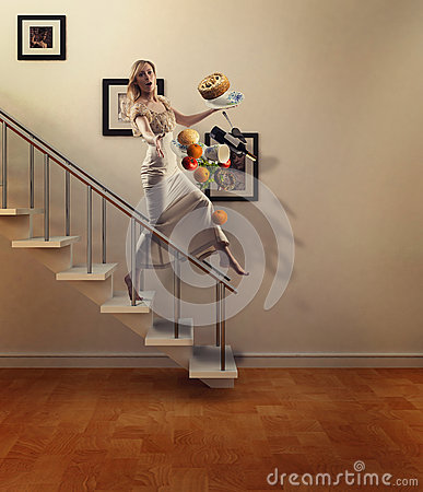 Beauty blond woman walking down stairs drops food