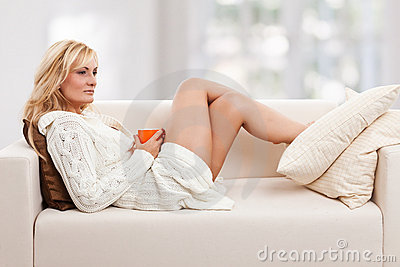 Beauty, blondie woman in a sofa
