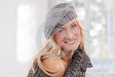 Beauty, blondie woman wear a grey-colored hat