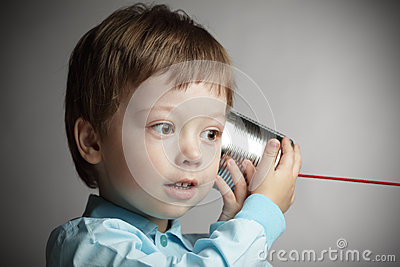 Boy listen tin can telephone