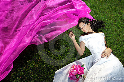 Beauty bride with a long purple veil