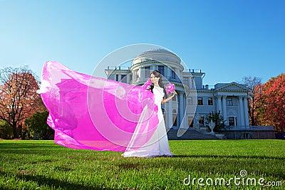Beauty bride with a long purple veil