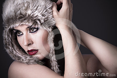 A beauty brunette girl with snow hat