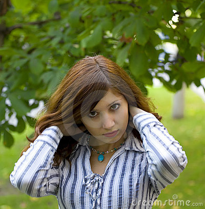 Beauty brunette in a park correct you hairstyle