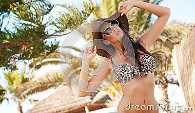 Beauty brunette on tropical island