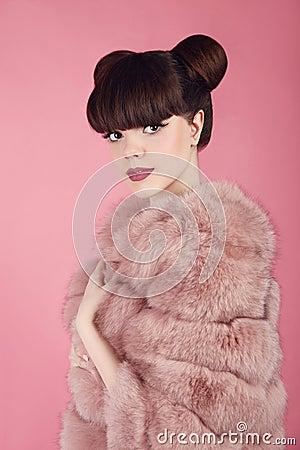 Free Beauty Bun Hairstyle.  Fashion Teen Girl Model In Pink Fur Coat. Stock Photo - 94927430