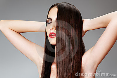 Beauty care. Woman with shiny slicked hairstyle
