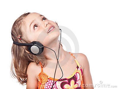 Beauty child with headphones looking up