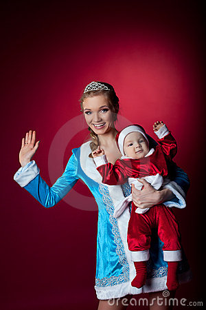 Beauty christmas girl play with baby santa claus
