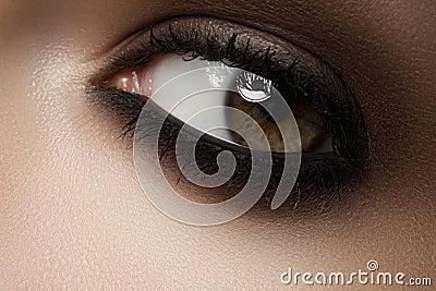Beauty cosmetics. Macro fashion smoky eyes make-up