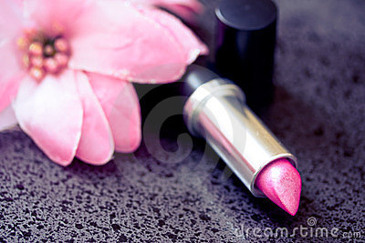 Beauty & cosmetics: pink lipstick & soft flower