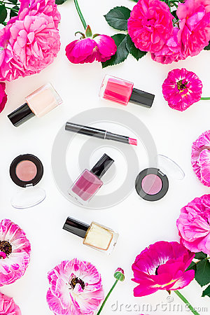Free Beauty Desk With Cosmetics, Lipstick, Eye Shadows, Nail Polish And Frame Of Pink Flowers On White Background. Flat Lay, Top View. Stock Photography - 95012032