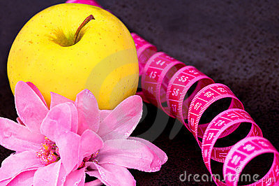 Beauty and diet: apple, flower, measuring tape