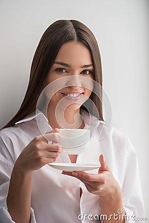 Beauty drinking coffee.