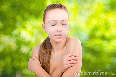Beauty eyes closed girl face on green background