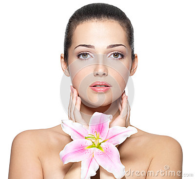 Beauty face of young woman with flower