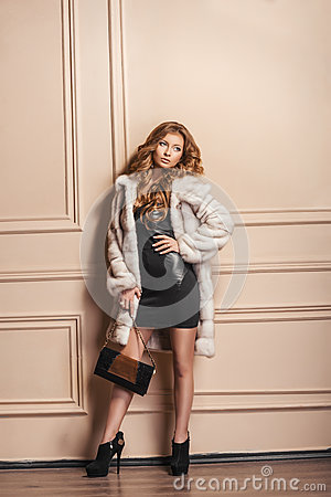 Free Beauty Fashion Model Girl In White Mink Fur Coat. Stock Image - 65243801