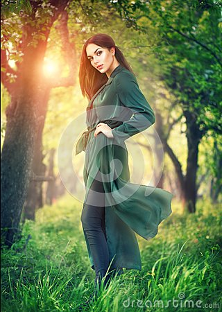 Free Beauty Fashion Model Girl Posing Over Blooming Trees, Enjoying Nature In Spring Apple Orchard Stock Photos - 115987933