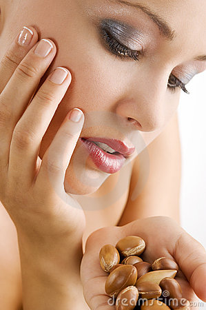 Beauty girl with argan seed