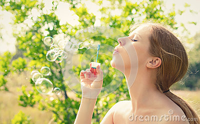 Beauty girl and bubbles on the nature